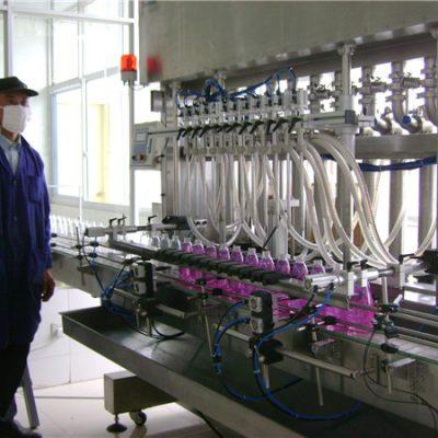 모자를 씌우기를 가진 자동적 인 회전하는 병 액체 충전물 기계